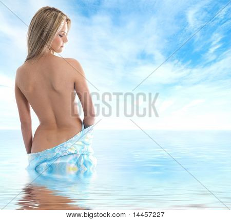 Young sexy blond in sari over sky and sea background