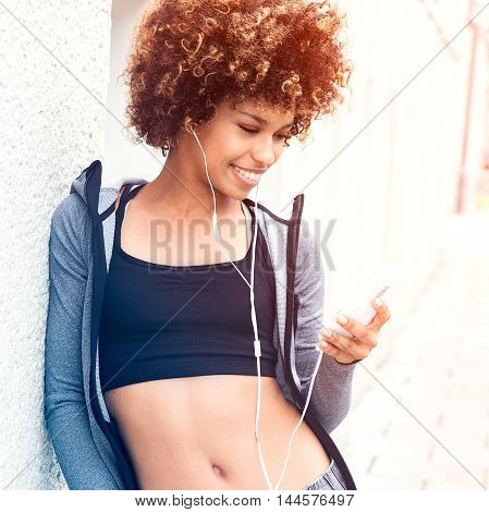 Fit Girl With Afro Posing Outdoor.