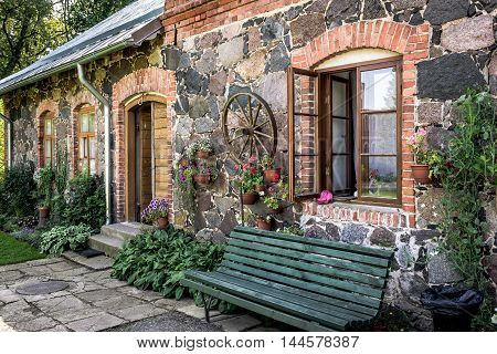 Stone facade wall of traditional Latvian house