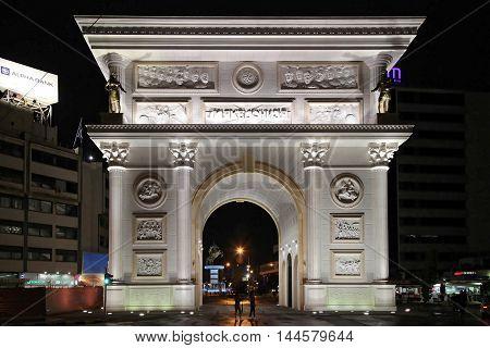 SKOPJE MACEDONIA - SEPTEMBER 16: Macedonia Gate in Skopje on SEPTEMBER 16 2012. Macedonia Gate Marble Arch Monument at Night in Skopje Macedonia.
