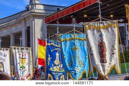 Banners May 13 Apparation Day Basilica of Lady of Rosary Bell Tower Fatima Portugal. Church created on site where three Portuguese Shepherd children saw Virgin Mary of the Rosary. May 13th day Virgin Mary appeared to the Peasants Basilica created in 1953.