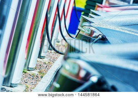 Charging Electric Vehicles Using Public Outdoor Electric Chargers. Modern Electric Cars in Use. Future of Transportation.