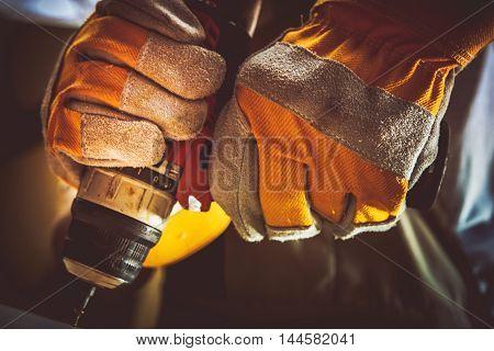 Construction Worker with His Screw Gun Closeup Photo