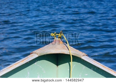 yellow rope in front of a shallop on a lake