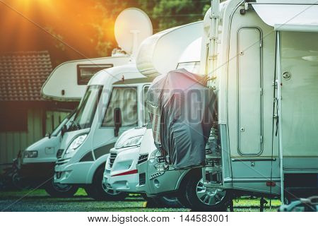 RV Camper Storage Place. Stored Recreational Vehicles on the Storage Parking Lot.