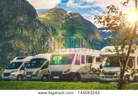 Scenic RV Park Camping. Few Camper Vans in Remote Location. RVing Theme.