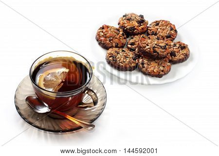 sweet biscuits and fruit tea with lemon