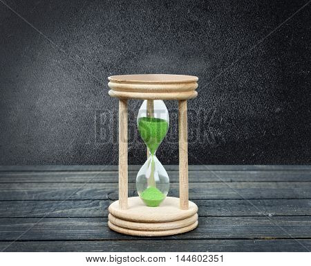 Hourglass close-up on wooden table