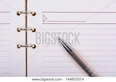 Luxury ball point pen on blank notebook sheet