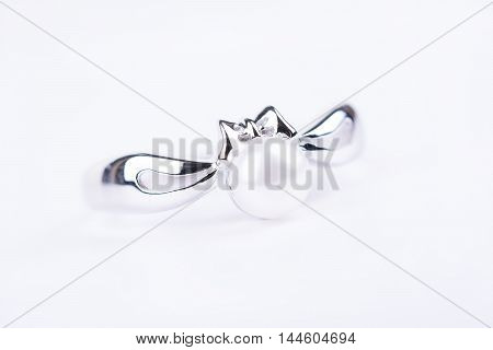 Perl ring on white background shallow dof