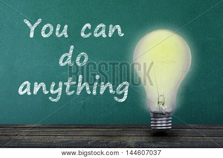 You can do anything text on green board and light bulb on table