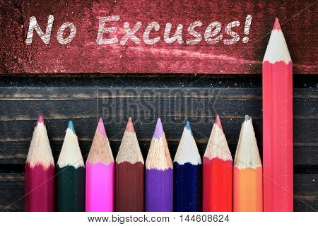 No Excuses text and group of pencil on wooden table