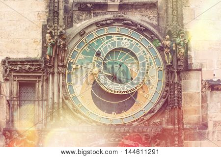 Prague Astronomical Clock (Orloj) in the Old Town Square in Prague, Czech Republic, Europe. Famous Landmarks in Praha. Vintage style toned