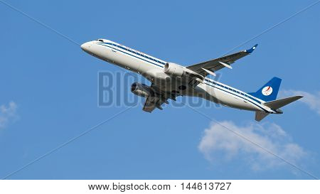 Moscow - July 31 2016: passenger jet Embraer ERJ-195LR (190-200LR) Belavia Airlines flies to Domodedovo airport and on a background of blue sky July 31 2016 Moscow Russia