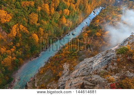 Early morning at colorful autumn with a view on the canyon of the river Tara in Montenegro from above. Deepest river canyon in Europe and it is protected as a part of Durmitor National Park and is a UNESCO World Heritage Site.