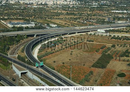 Athens, Greece - August 15 2016: Attica Tallway (Attiki odos) aerial view. This motorway is the fastest way to drive from the airport to Athens. There is a tall sytem installed.