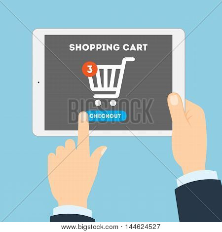 Online shopping concept. Buying products and service through Internet. Shopping cart with checkout button.