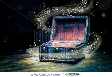 Beautiful Concept Greeting Card Of Opened Vintage Chest Treasure With Miracle Magic Light On Wooden
