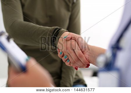 Medicine Doctor Shake Hands As Hello With Female Patient