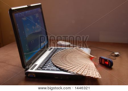Manual Fan And Mouse Over An Open Laptop
