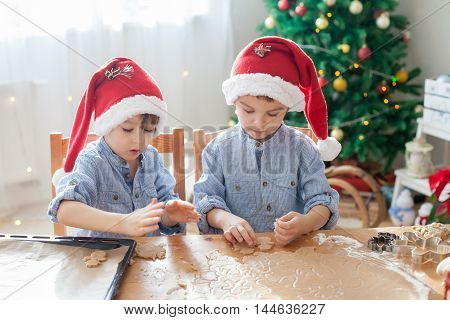 Two Cute Boys With Santa Hat, Preparing Cookies At Home, Christmas Tree