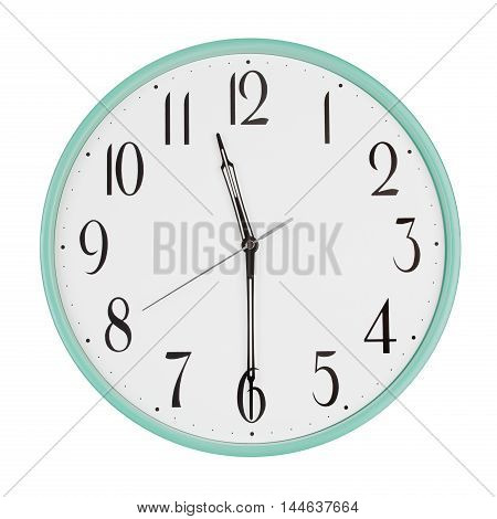 Half past eleven on the round clock