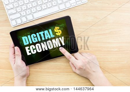 Finger Click Screen With Digiral Economy Word With Keyboard On Wooden Table,,business Concept