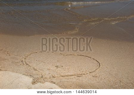 Heart Drawing In The Sand .ocean Waves Gently Wash Away