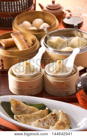 Chinese Dim Sum shrimp dumplings on white dish in restaurant