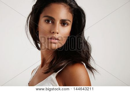 Brunette Woman Watching At Camera On A White Background