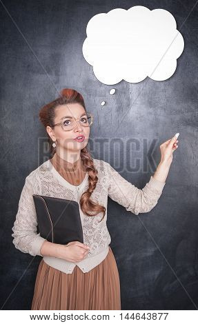 Thoughtful Teacher In Glasses With Piece Of Chalk