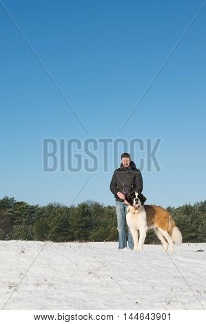 Owner with big rescue dog in snow
