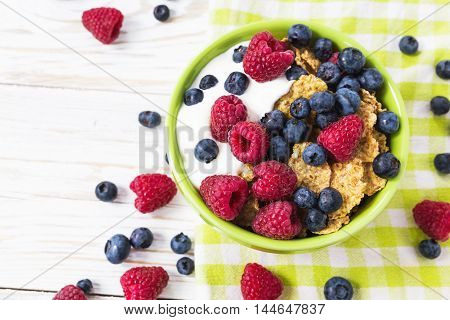 Healthy Corn Flakes Breakfast On The White Wooden Table