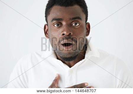Close Up Portrait Of Young Dark-skinned Student Or Employee Looking At Camera With Surprised Guilty