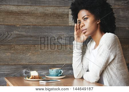People And Lifestyle Concept. Cute African American Female Office Worker, Resting Her Elbow On Table