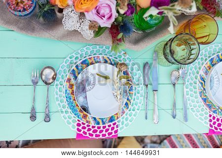 served table in boho style top view