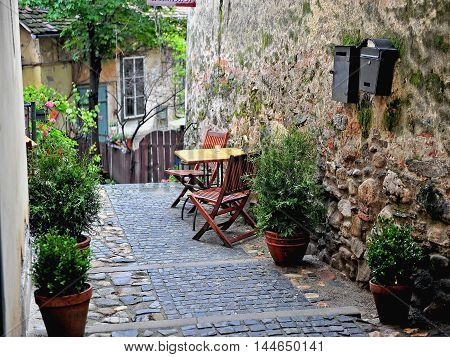 Courtyard with the table and chairs Sibiu town Romania poster