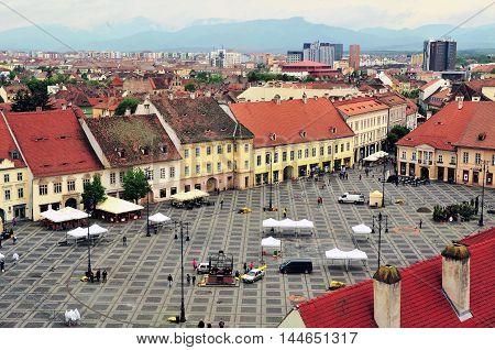SIBIU ROMANIA - MAY 4: Top view of the city square of Sibiu Romania on May 4 2016. Sibiu is the city in Transylvania region in central Romania.