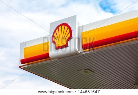 LENINGRAD REGION, RUSSIA - JULY 31 2016: The emblem of the Royal Dutch Shell oil company. Shell is an Anglo-Dutch multinational oil and gas company