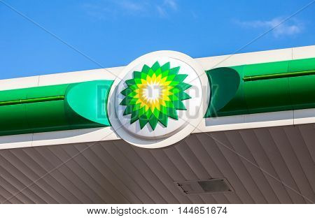 NOVGOROD REGION RUSSIA - JULY 31 2016: BP - British Petroleum petrol station logo against blue sky. British Petroleum is a British multinational oil and gas company