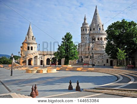 BUDAPEST HUNGARY - MAY 20: View of Fisherman's Bastion with a nice morning sunlight in Budapest city on May 20 2016. Fisherman's Bastion is a terrace in neo-Gothic and neo-Romanesque style in Budapest Hungary.