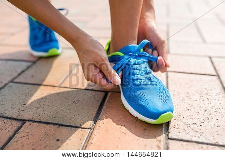 Woman fixing the shoelace