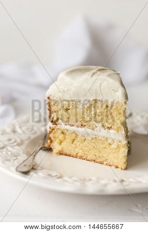 Moist double layered orange cake with white chocolate Moist double layered orange cake with white chocolate frosting