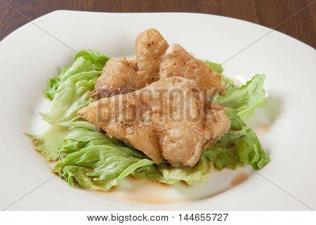 Fried from simmering pig foot of Sampei on white platter