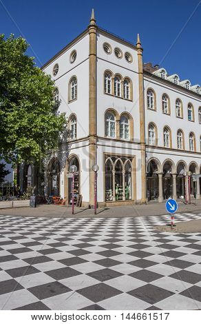OSNABRUCK, GERMANY - AUGUST 25, 2016: Checkerboard pattern in front of an old building in Osnabruck, Germany