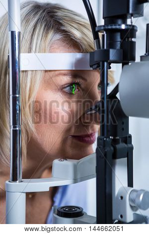Close-up of eye examination on slit lamp in ophthalmology clinic