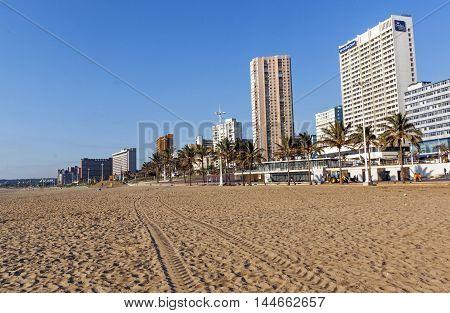 Empty Beach Against Golden Mile City Skyline
