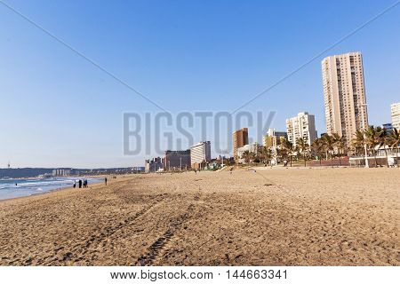 Quiet Early Morning Beach Against City Skyline In Durban