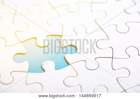 White puzzle with missing part on blue background. Business concept. Vintage toning