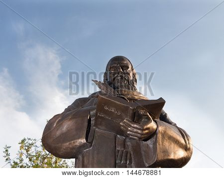 Astrakhan Russia - August 27 2016: First monument to Persian philosopher and poet Omar Khayyam Nishapuri in Russia. Astrakhan. Monument on sky background.
